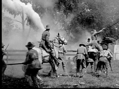 1913 reenactment b/w wide shot army officers, soldiers, and horse mounted cavalry shooting at each other with rifles and pistols during civil war battle reenactment / usa  - wide shot stock videos & royalty-free footage