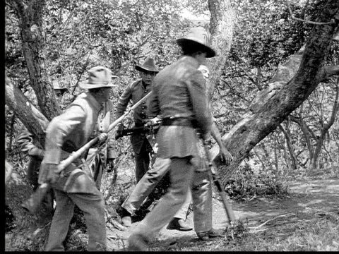 1913 reenactment b/w wide shot army soldiers capturing wounded man and taking him prisoner during civil war battle reenactment / usa  - prisoner of war stock videos & royalty-free footage