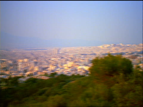 wide shot PAN Athens cityscape to Parthenon temple atop Acropolis / Athens, Greece