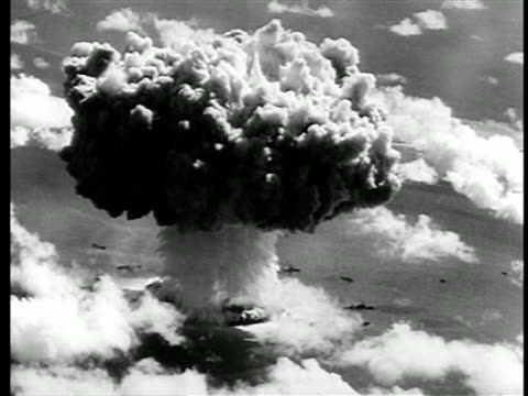AERIAL wide shot atom bomb exploding in test / newsreel