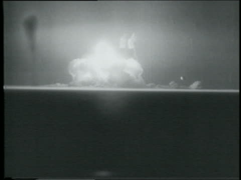 B/W 1945 wide shot atomic bomb explosion in Alamogordo New Mexico / newsreel