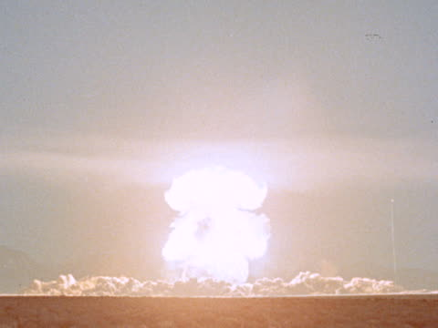 wide shot atomic explosion / mushroom cloud in desert - atomic bomb stock videos & royalty-free footage