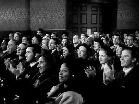 1951 Wide shot Audience applauding performance by contralto singer Marian Anderson in concert hall/ USA