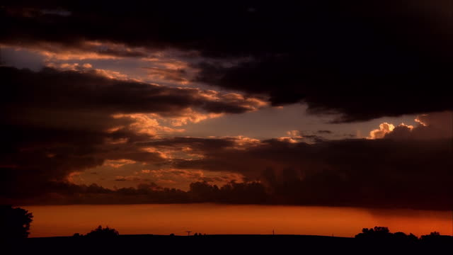 wide shot backlit clouds in sky at dawn or dusk / iowa - 1987 stock videos & royalty-free footage