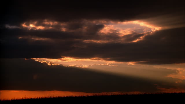wide shot backlit clouds in sky at dusk or dawn / iowa - 1987 stock videos & royalty-free footage