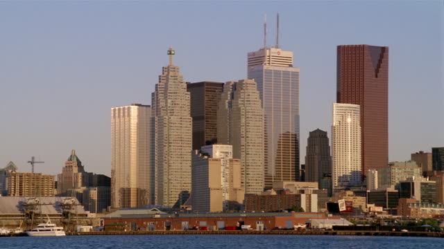 wide shot bce place, commerce court west and surrounding buildings in skyline at sunrise / toronto - kelly mason videos stock videos & royalty-free footage