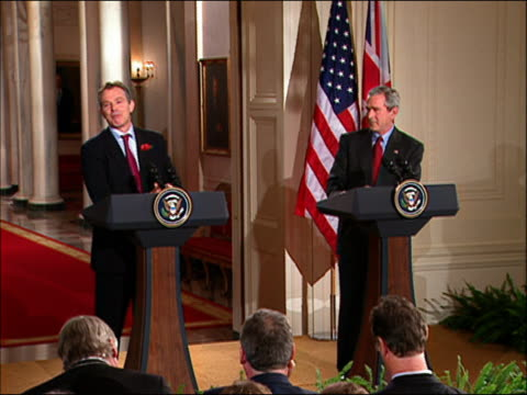wide shot blair and bush facing the press / bush reaffirming blair's support of war in iraq / dc / audio - anno 2004 video stock e b–roll