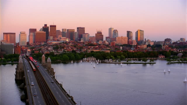 Wide shot Boston skyline with Charles River and Longfellow Bridge in foreground