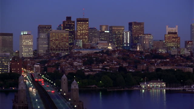 Wide shot Boston Skyline with Longfellow Bridge and Charles River in foreground
