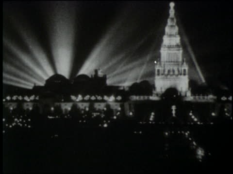 stockvideo's en b-roll-footage met b/w 1915 wide shot brightly lit tower of jewels at night / panamapacific expo / san francisco world's fair - 1915