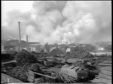 b/w 1934 wide shot burned debris smoke after chicago stockyard fire / newsreel - 1934 stock videos & royalty-free footage
