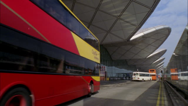 wide shot bus arriving at hong kong airport/ hong kong - hong kong international airport stock videos and b-roll footage
