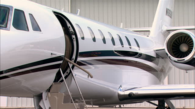 wide shot businessman exiting private jet at opa locka airport/ miami, florida, usa - corporate jet stock videos & royalty-free footage