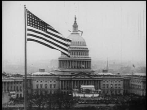 B/W 1929 wide shot Capitol Building with US flag in foreground / Washington DC / newsreel