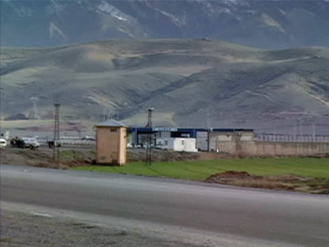 wide shot car driving on road past habur gate/ silopi sirnak province turkey - silopi stock videos and b-roll footage