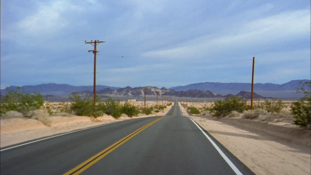 wide shot car point of view driving on desert highway - moving process plate stock videos and b-roll footage