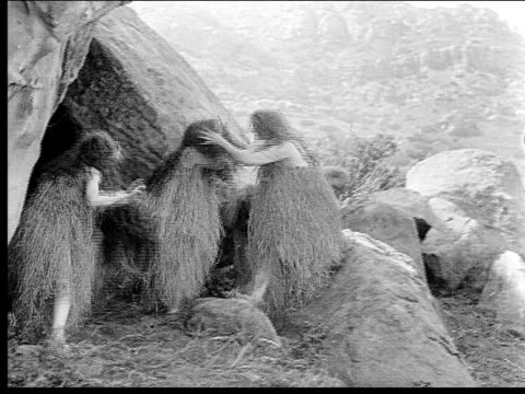 1914 B/W Wide shot Cavewomen playing and pulling each other's hair