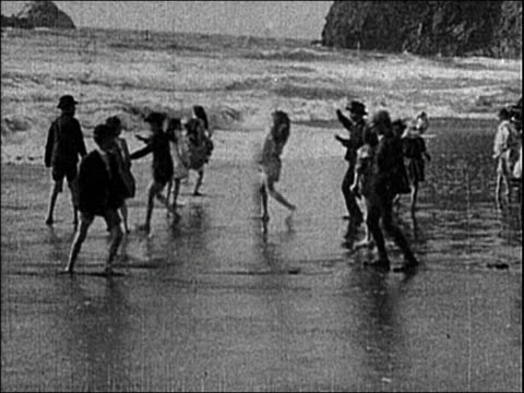 1903 wide shot children running and playing in surf on ocean beach / san francisco / edison paper print - 1903 stock-videos und b-roll-filmmaterial