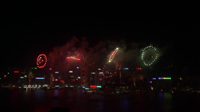 Wide shot Chinese New Year fireworks in Victoria Harbour/ Hong Kong