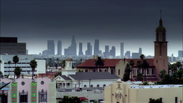 wide shot churches around hollywood boulevard with downtown skyline in distance / los angeles, california - overcast stock videos & royalty-free footage