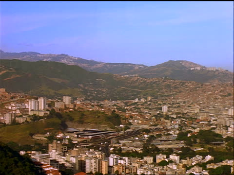wide shot city of caracas with mountains in background / venezuela - 1999年点の映像素材/bロール