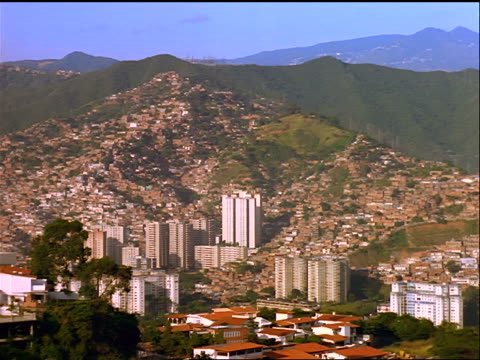 wide shot city of Caracas with mountains in background / Venezuela