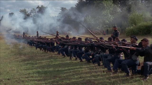 wide shot civil war soldiers firing guns - reenactment stock videos & royalty-free footage