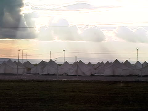 wide shot clouds floating above large group of tents in refugee camp/ silopi sirnak province turkey - silopi stock videos and b-roll footage
