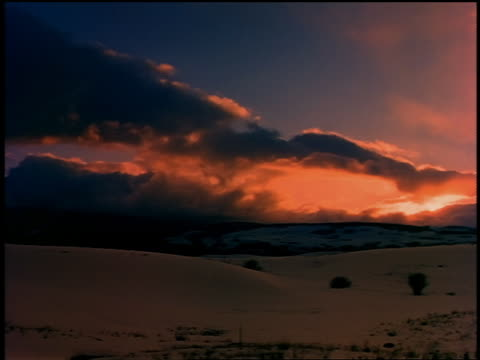 wide shot clouds rolling over snow covered hills at dusk / colorado - 1989 stock videos & royalty-free footage