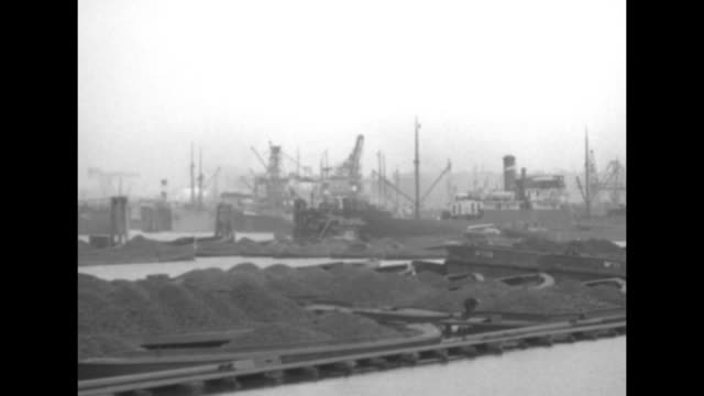wide shot coal barges from great britain docked in hamburg great britain assisted germany with coal due to the french occupying the ruhr district for... - coal stock videos & royalty-free footage