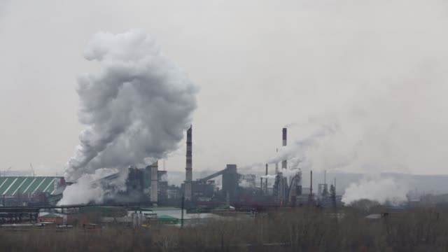 Wide shot coking coal sits in storage at a coke plant operated by OOO Industrial Metallurgical Holding Management Co on the River Tom in Kemerovo...