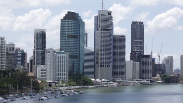 Wide shot commercial buildings stand near the Brisbane River in Brisbane Australia on Thursday Nov 13 2014 Medium shot commercial buildings stand...