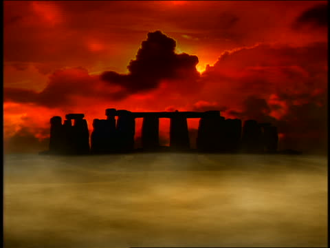wide shot composite lightning + time lapse sunrise above stonehenge surrounded by mist + dark clouds - 1998 stock videos & royalty-free footage