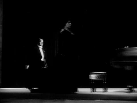wide shot contralto singer marian anderson walking onstage and bowing next to pianist during performance/ usa - 1951年点の映像素材/bロール