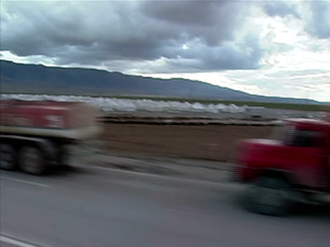 wide shot convoy of oil tankers lining road near tents and refugee camp/ silopi sirnak province turkey - silopi stock videos and b-roll footage