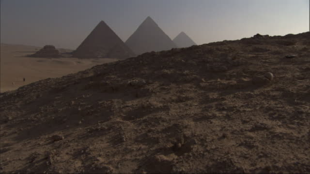 Wide Shot, crane - The Great Pyramids rise above the Giza Plateau / Egypt
