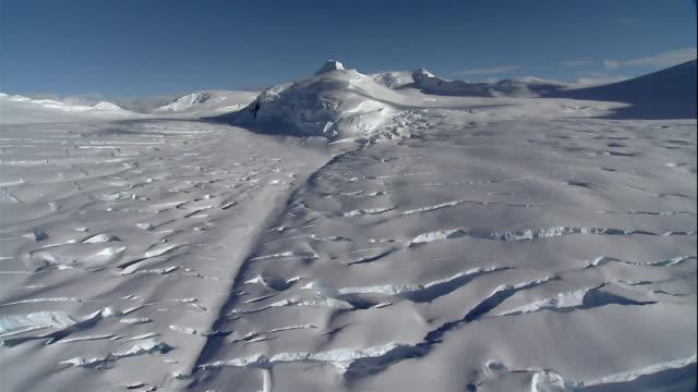 wide shot crevasses forming in ice on glacier/ antarctica - crevasse stock videos & royalty-free footage
