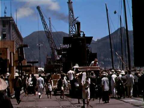 1939 wide shot crowd at waterfront/ hong kong - 1930 1939 video stock e b–roll