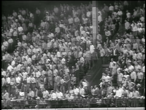 b/w 1947 wide shot crowd rising to feet in stands at ebbets field / brooklyn ny / newsreel - ebbets field video stock e b–roll