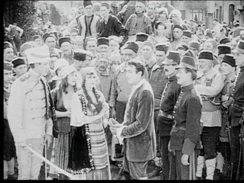 1916 b/w wide shot crowd soldiers confronting man and woman in front of peasant crowd - 1916 stock videos & royalty-free footage