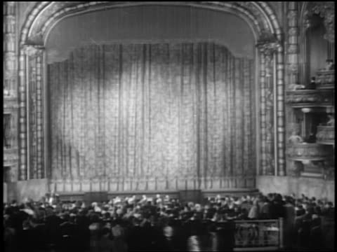B/W 1927 wide shot crowded theater at premiere of Glorifying the American Girl in NYC / newsreel