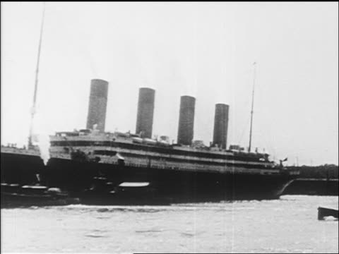 B/W 1912 wide shot cruise ship leaving harbor / newsreel