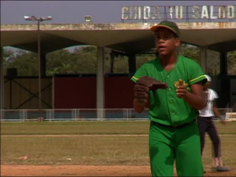 2003 wide shot Cuban Little League baseball players practicing on a baseball field / Cuba