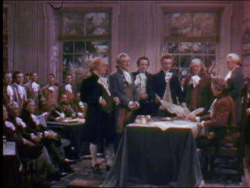 1956 wide shot delegates standing at table in ceremony signing the declaration of independence / audio - benjamin franklin stock videos & royalty-free footage