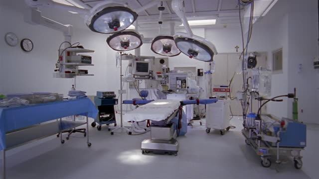 wide shot dolly shot operating table and equipment in operating theater - operating theatre stock videos & royalty-free footage