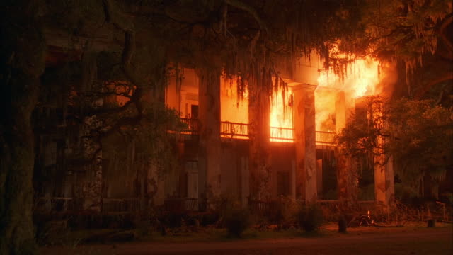 wide shot dolly shot plantation mansion on fire / geismar, louisiana - burning stock videos & royalty-free footage