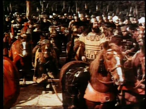 wide shot dolly shot REENACTMENT crowd of Roman + barbarian armies standing together on horseback