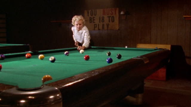 wide shot elderly woman playing pool / sign ' you must be 18 to play' on wall / san francisco, california - 1990 stock videos & royalty-free footage
