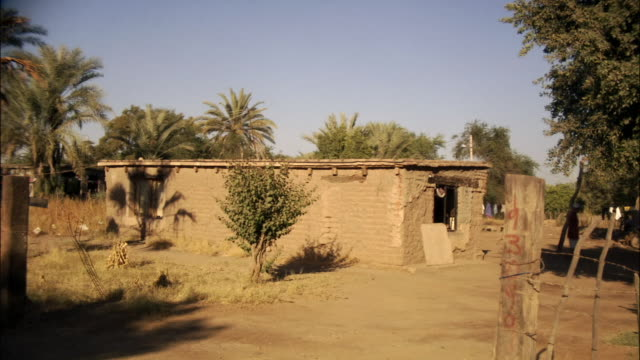 Wide shot exterior of adobe house