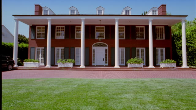wide shot exterior of mansion with columns - establishing shot stock videos & royalty-free footage